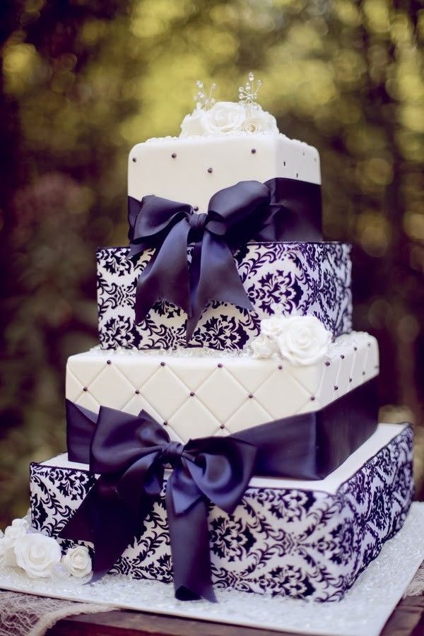 purple wedding cakes with ribbon