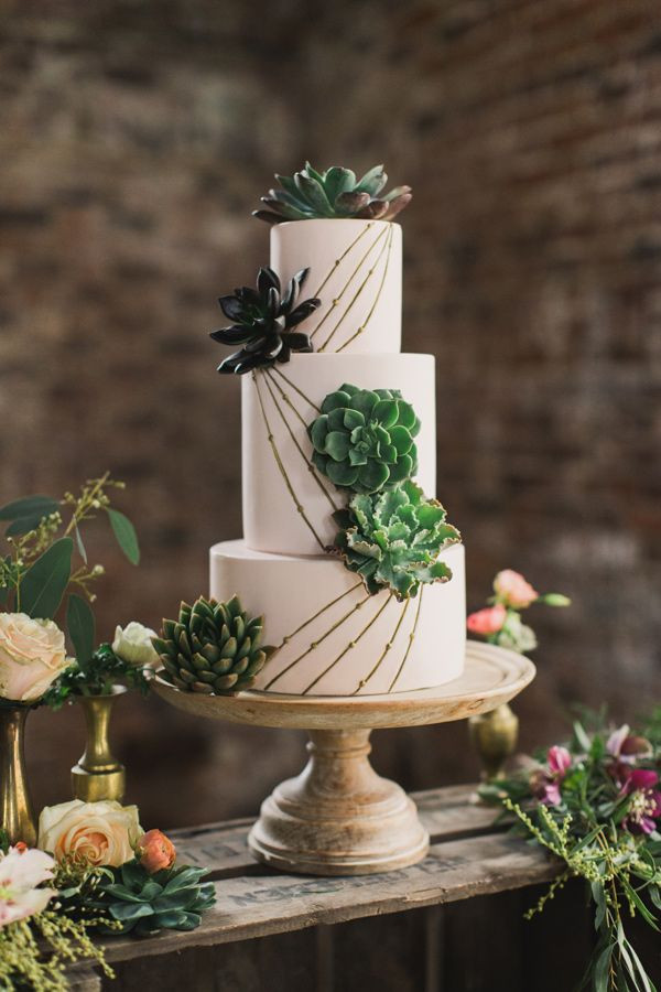 Gorgeous gold and green succulent wedding cake