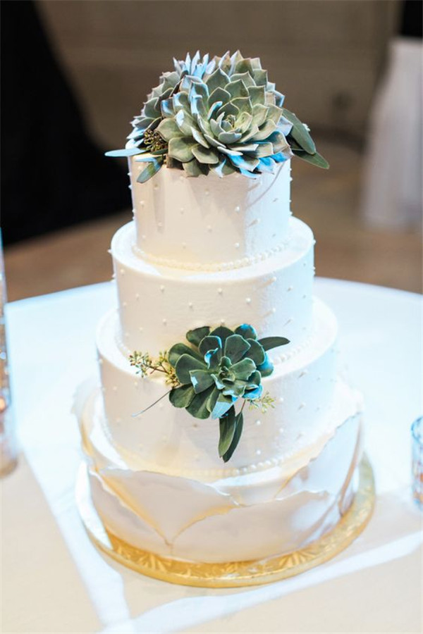 Succulent-adorned layered wedding cake