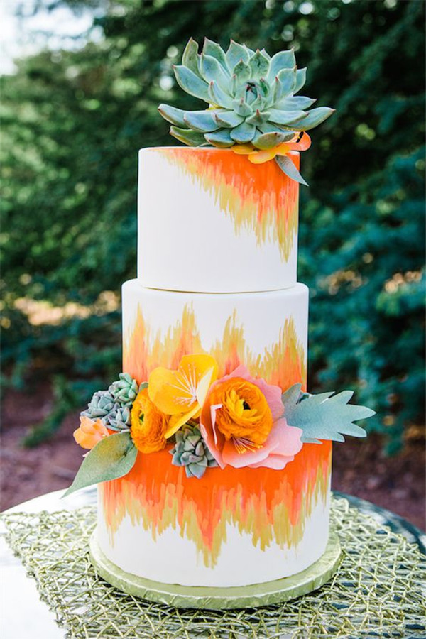 colorful wedding cake with succulent