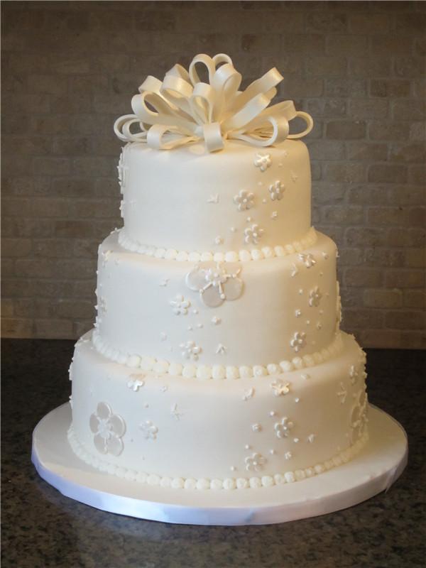 White Pearl Bow Wedding Cake