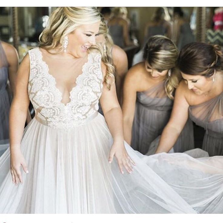 Top 11 plus size wedding dresses you can39t resist for Off white plus size wedding dresses