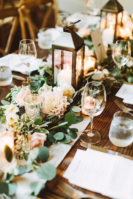 Greenery wedding centerpiece with lanterns