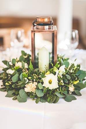 Low Wedding Centerpieces If you want to incorporate more greenery into your wedding table