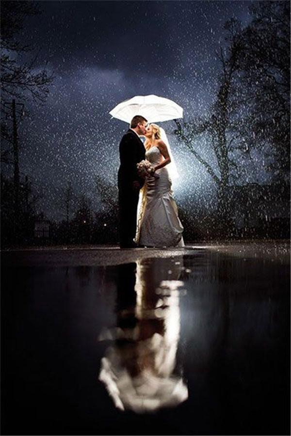 Beautiful rainy wedding day night photo