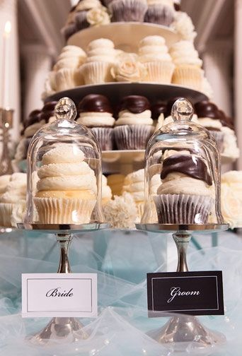Fun and beautiful Cupcake tower with brides choice and grooms choice
