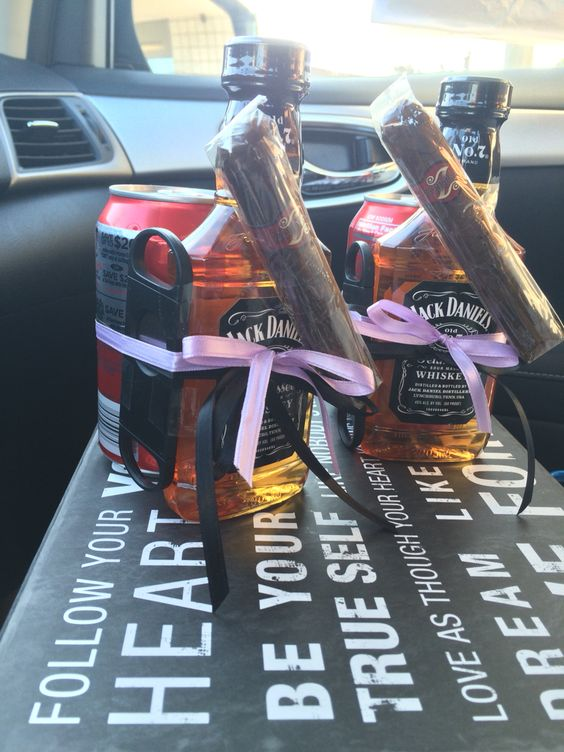 Groomsmen little gift jack Daniels and coke along with a cigar and cutter