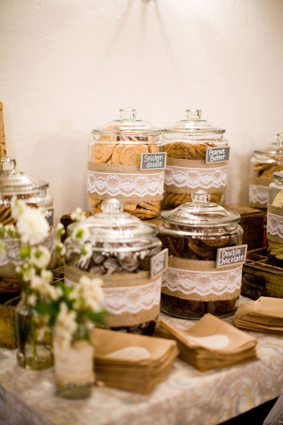 Lace and burlap around cookie jars from a cookie jar table