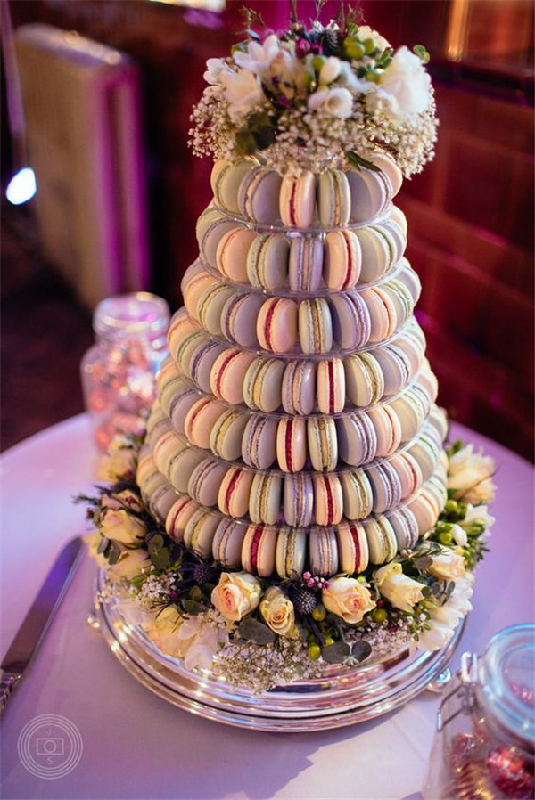 Macaron wedding tower dressed with flowers