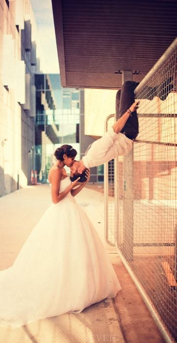 Spiderman kiss such a cute wedding photo