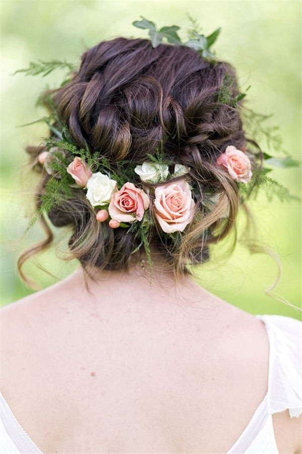 Bridal hairstyle with greenery and flowers