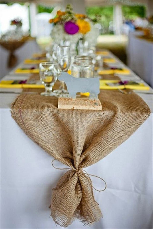 Burlap runners on top of the table linens
