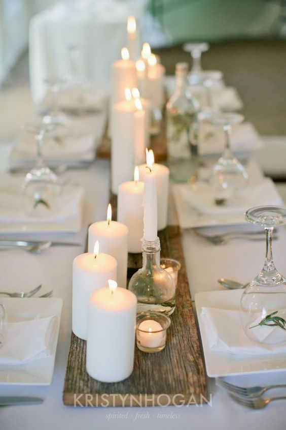 Candles on barn wood minimalism & romance in one