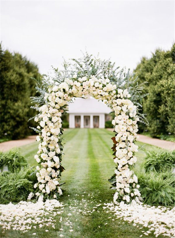 Elegant White Rose Ceremony Arch photography / katiestoops