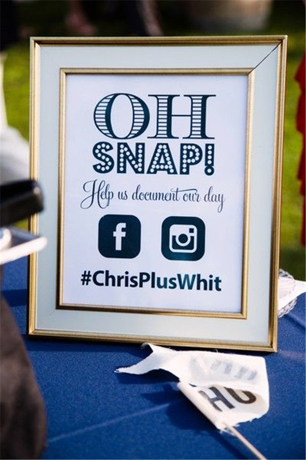 Encourage guests to share their photos with custom wedding hashtag sign