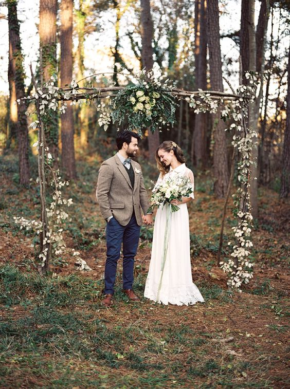 Floral adorned wedding ceremony arch for woodland wedding