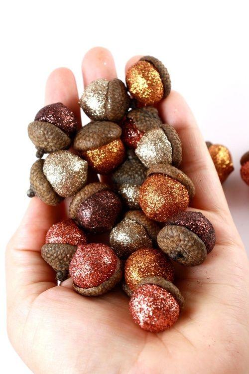 Glitter acorns. Good vase filler for a fall wedding