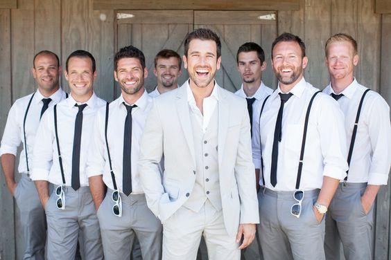Gray pants and suspenders for the groomsmen Photo by Shaun & Skyla Walton