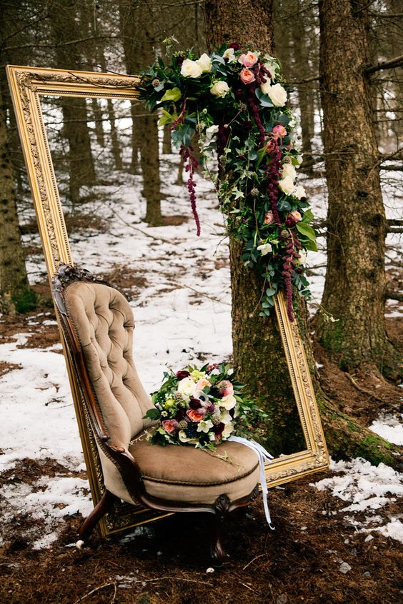 Large Ornate Frame with Vintage Chair adorned with floral decor perfect for woodland wedding