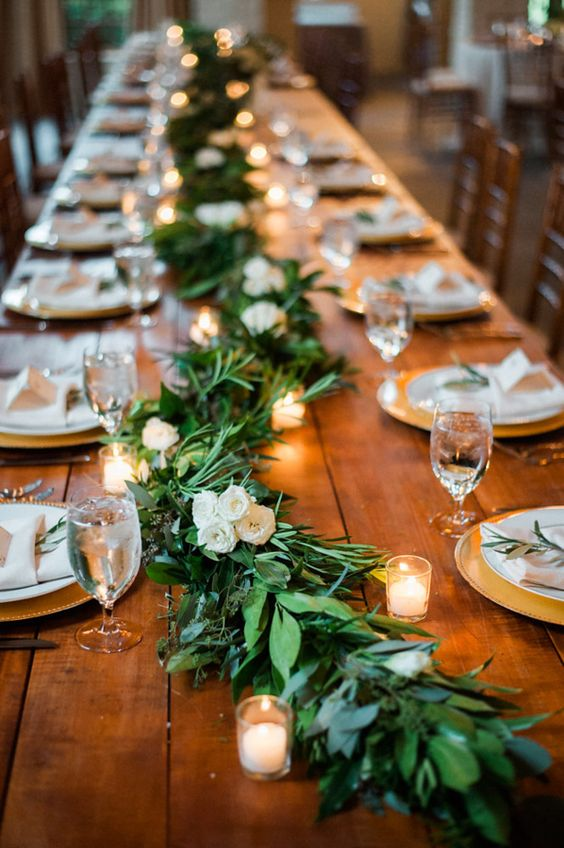 Rustic garland and candle covered wedding tables
