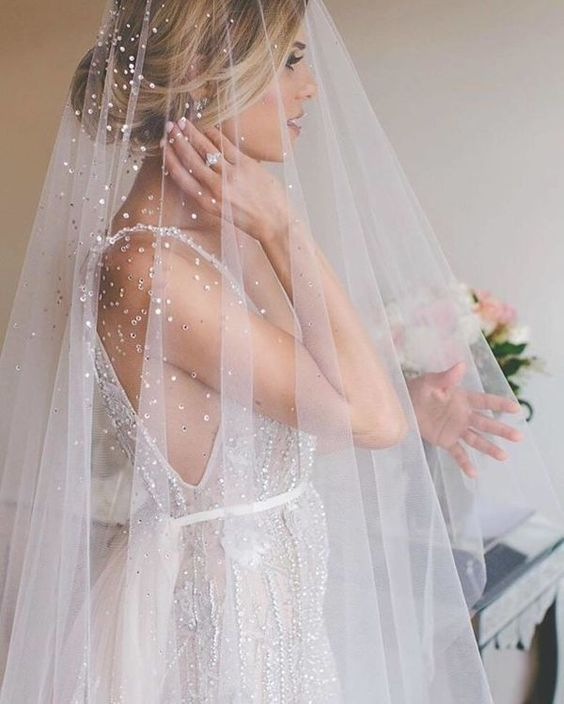 Sequined Wedding Veil From a jewel adorned veil to the dazzling dress beadwork