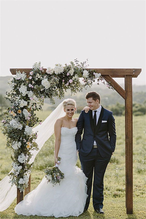Stunning wedding arch with cascading floral arrangement in a neutral palette Photograph by @heart and colour