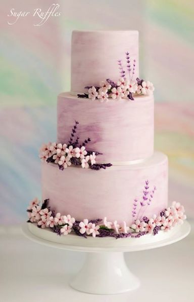 Sugar Ruffles Elegant Wedding Cakes with purple sugar flowers