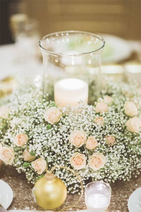 Sweet and charming centerpiece with Baby's breath and champagne spray roses