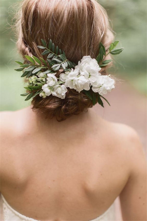 18 wedding updo hairstyles with greenery decorations wedding updo hairstyle with greenery and white flower junglespirit Images