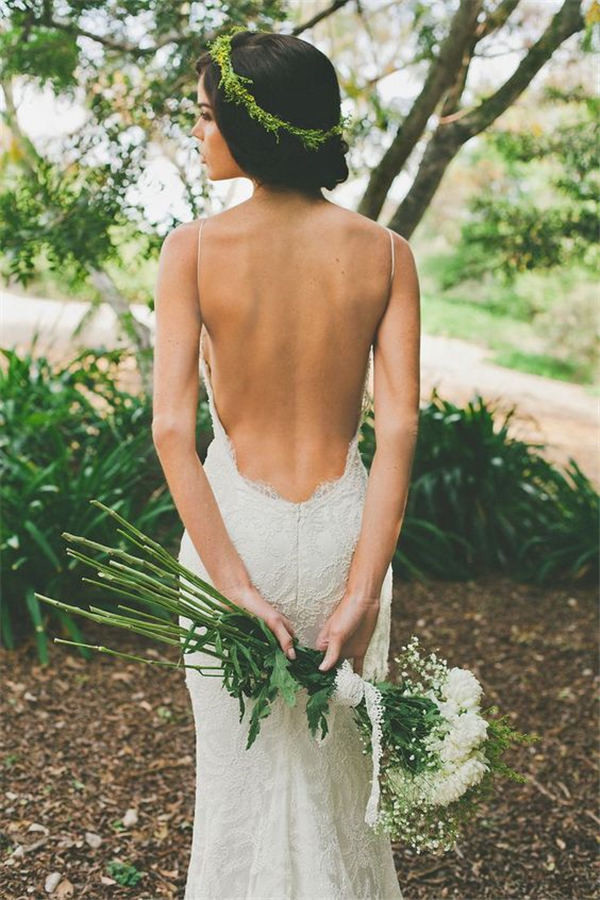 backless bohemian wedding gown and greenery wedding hair decor
