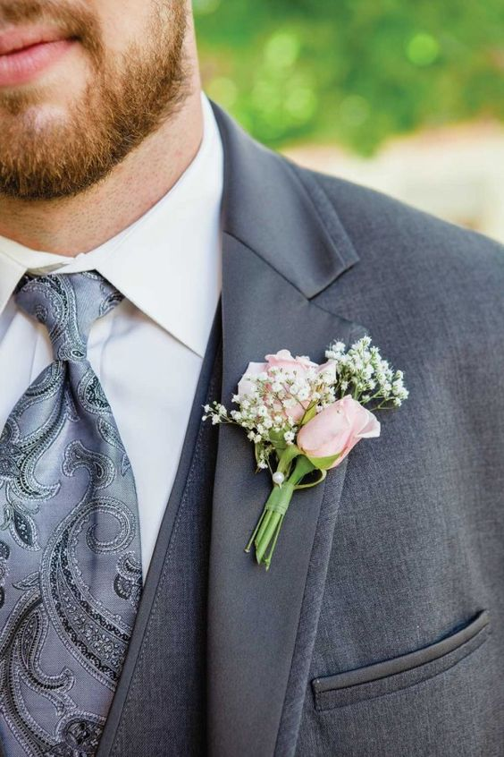 boutonniere only with a crimson rose instead of pink and a piece of wheat in addition to the baby's breath