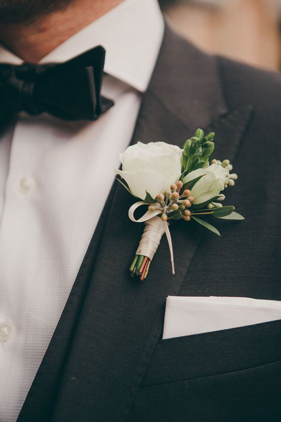 classic boutonniere and groom look photo by Christine Lim