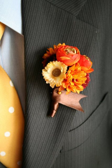 orange fall boutonniere for groom