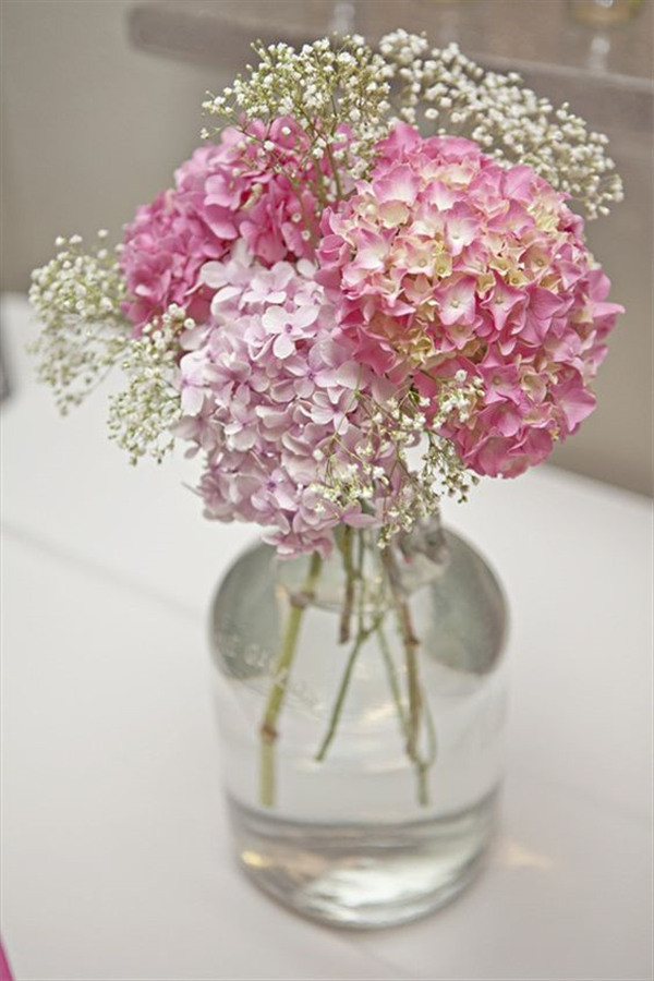 pink hydrangeas and baby's breath in glass vase
