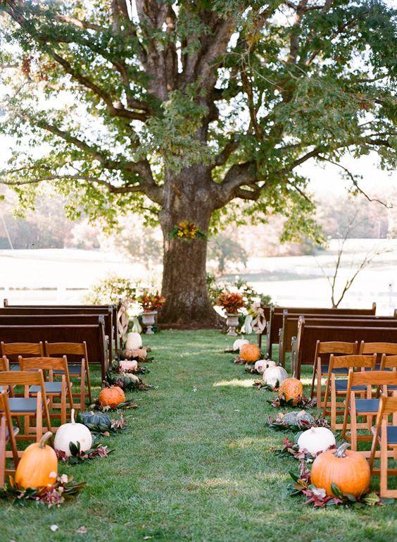 pumpkin lined fall wedding aisle