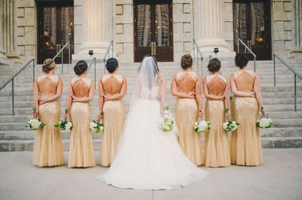 A Black and Gold 1920s Inspired Wedding with gold bridesmaid dresses