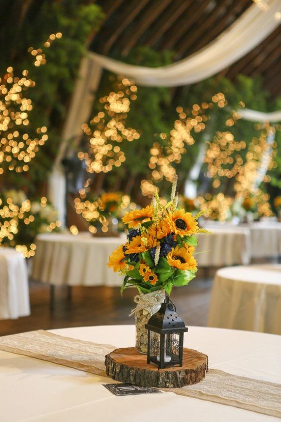 23 bright sunflower wedding decoration ideas for your rustic wedding centerpieces with a rustic wedding with a beautiful barn and a sunflower theme junglespirit Image collections