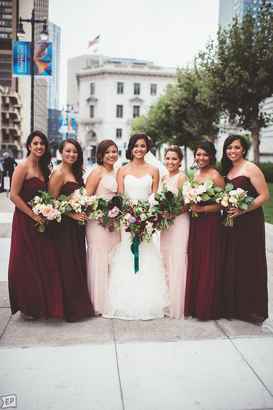 Dress up your bridesmaids in burgundy-colored dresses