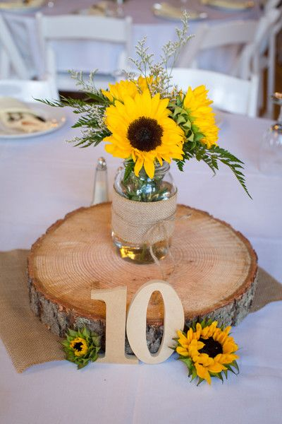Rustic wedding sunflower centerpieces by Lynette Smith Photography