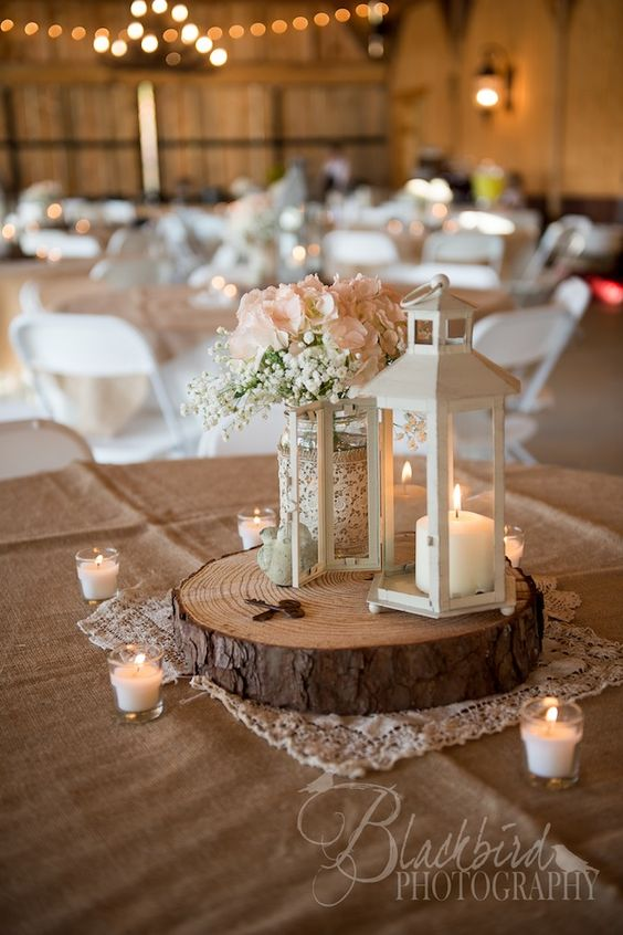 Rustic wood and lanterns wedding centerpieces ideas