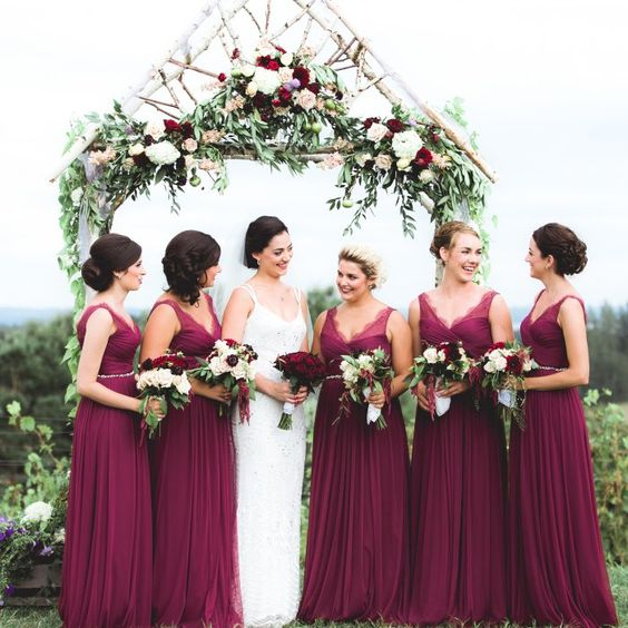 The bridesmaids wine colored bhldn dresses served as the for Wine colored wedding dresses