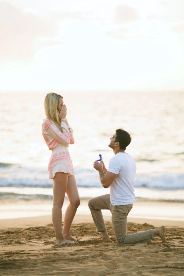 This beach proposal is absolutely perfect.