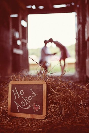 chalkboard message with couple in the background out of focus. such a sweet photo!