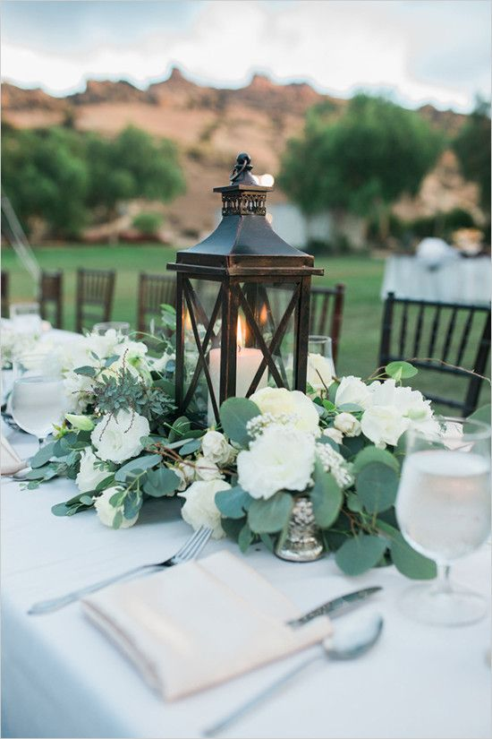 lantern centerpiece at wedding chicks