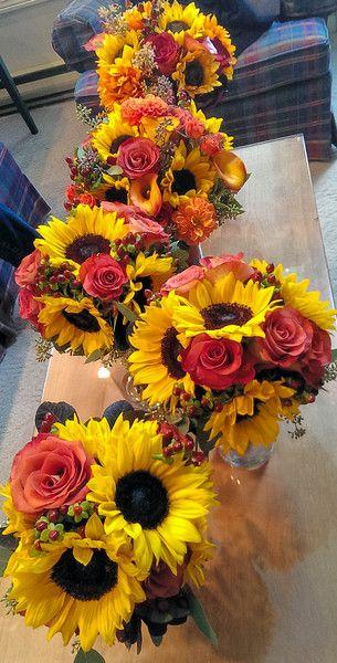sunflowers and burgundy hypericum berries wedding centerpieces ideas
