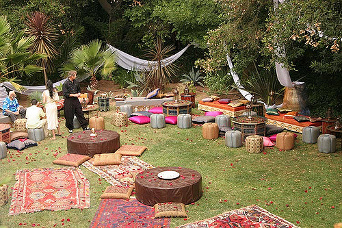 Bohemian wedding receptionwith mismatched rugs and low tables