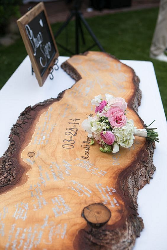 Boho wedding ideas This wooden guest book is AMAZING