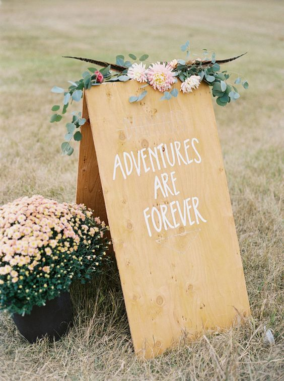 Boho wedding signs - photo by Jeremiah and Rache Photography
