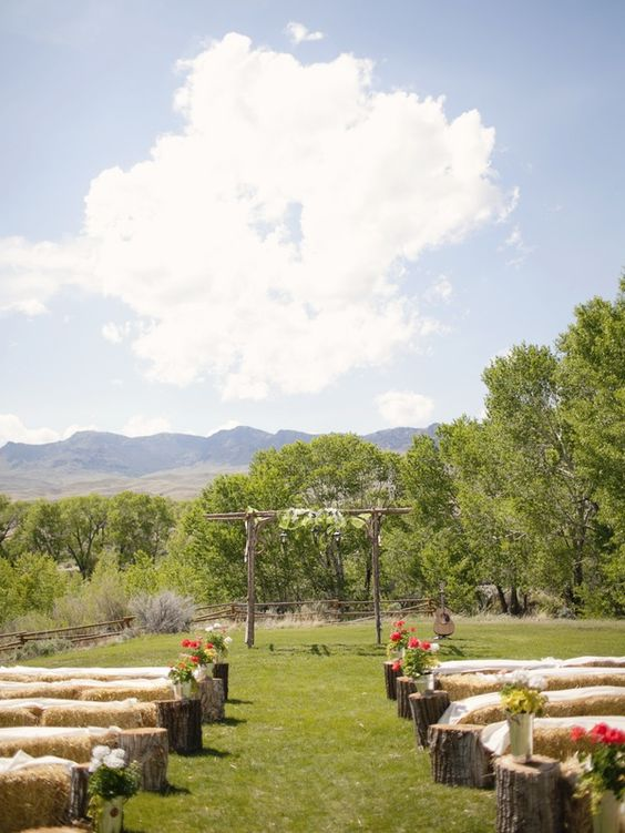 Hay bale seating & arbour And beautiful tree stumps at the ends of each row