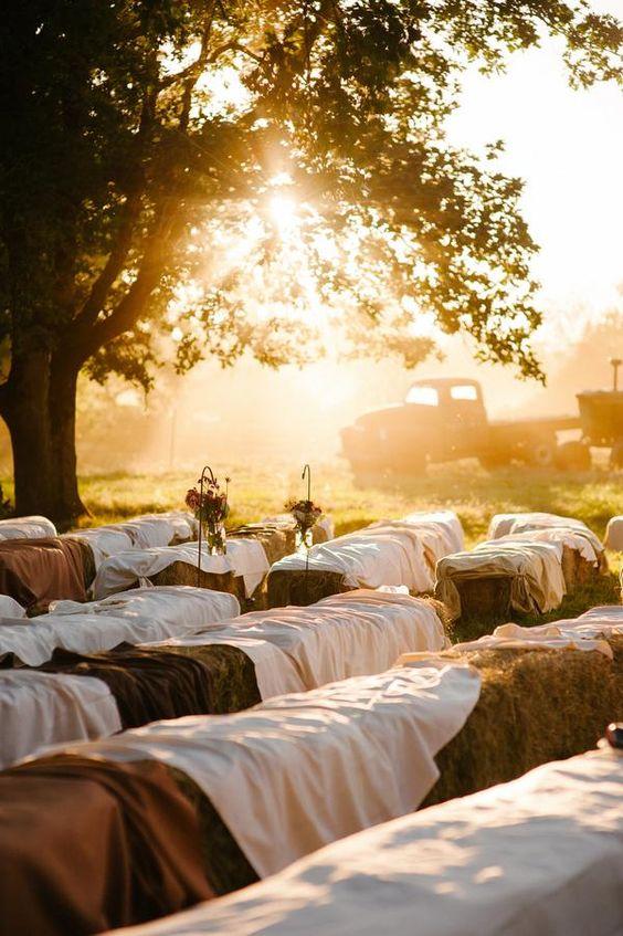 Love this hay bale idea for a farm wedding